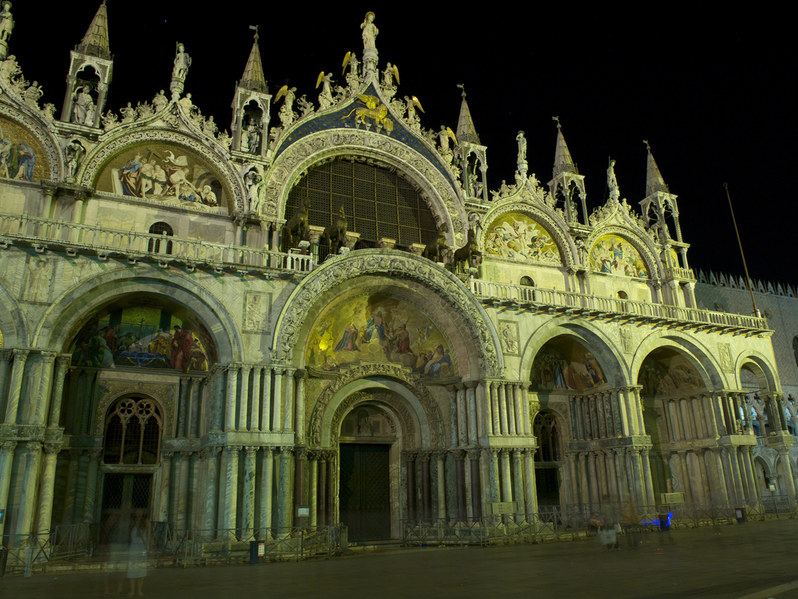the ghosts of tourists passing in front of the Basilica on Piazza San Marco, Venice, Italy