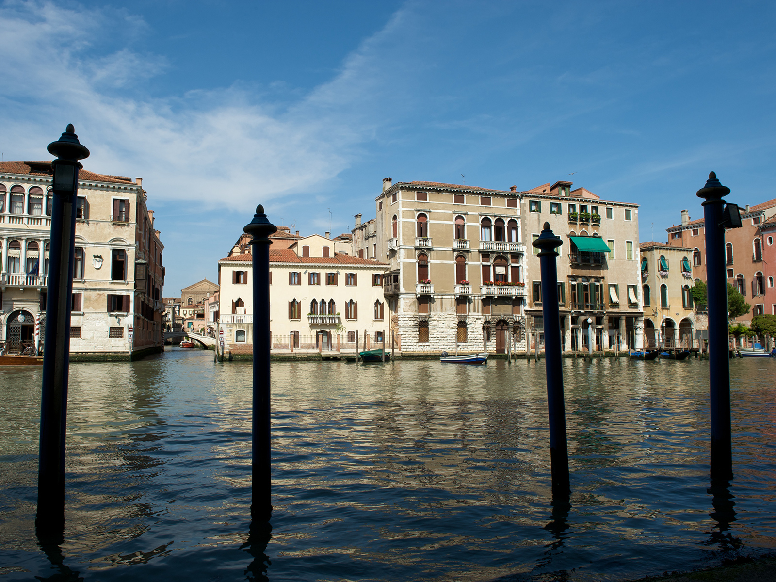mooring posts on the side of the Grand Canal in Venice, Italy